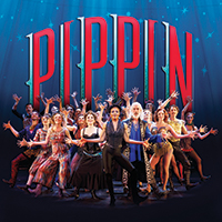 The Cast of Pippin dancers in front of the Pippin Sign